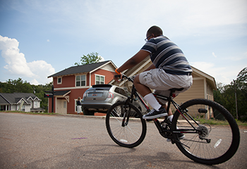 Boy riding his bike in a Greenville neighborhood