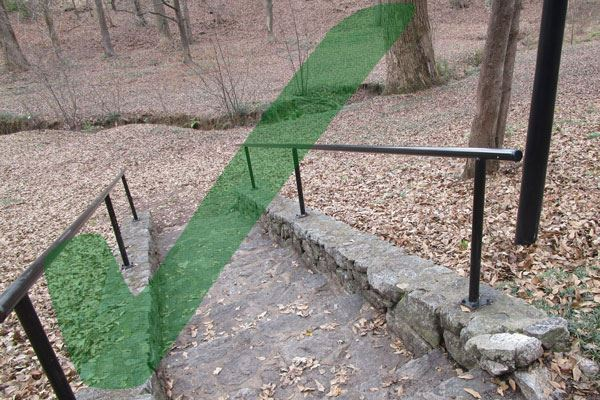 Image showing completed hand rail work with a checkmark over the photo