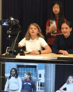 Students recording the morning news