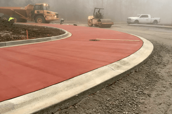 photo of trucks building a traffic circle