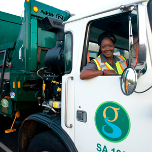 Garbage truck driver sitting at the wheel