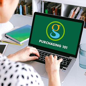 Woman sitting at a computer with title page that says Purchasing 101