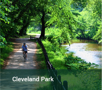 Cyclist riding along a trail in Cleveland Park