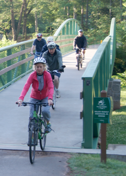cyclists crossing bridge near Cleveland Park